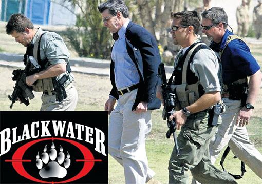 Служащие компании «Blackwater» охраняют Пола БРЕМЕРА, назначенного главой временной гражданской администрации Ирака после свержения ХУСЕЙНА