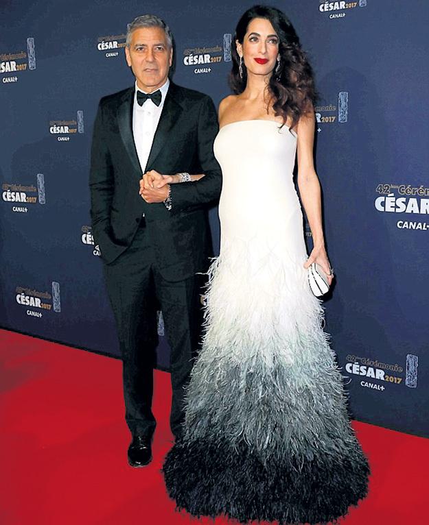 В Париже на церемонии вручения кинопремии «Сезар» Амаль КЛУНИ блистала в платье от ВЕРСАЧЕ за умопомрачительные 120 тысяч фунтов стерлингов, впрочем, Джордж был тоже не лыком шит