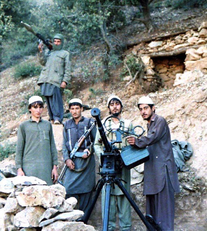 Моджахеды ИОА, вооружённые ДШК, АКМС и РПГ-7, 1987 год. Фото: Википедия